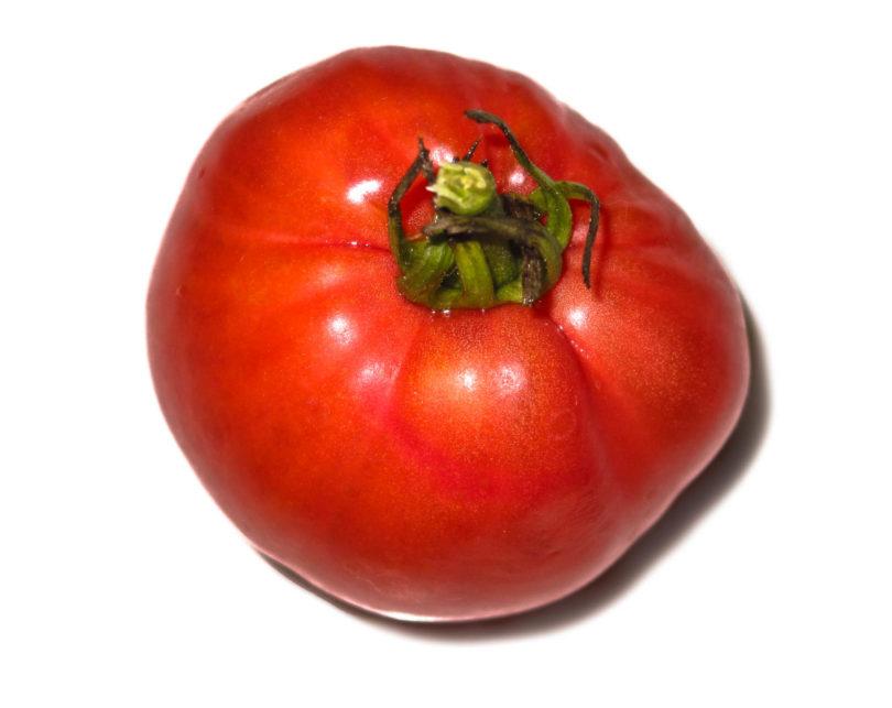 Die Früchte von der Tomate German Red Strawberry schmecken aromatisch, sind mittelgroß bis groß und reifen spät ab.
